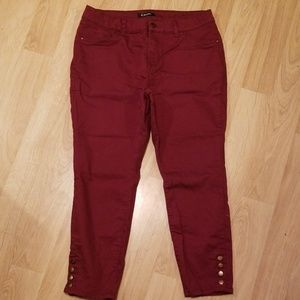 Burgandy jeggings. Button detail on ankles. 14